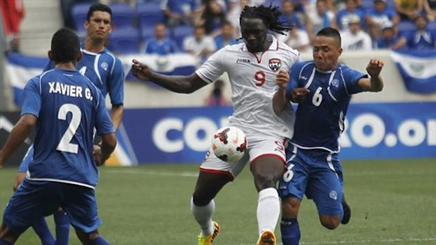 Trinidad and Tobago's Kenwyne Jones fights for the ball against El Salvador's Richard Menjivar during their CONCACAF Gold Cup game in New Jersey (Reuters)