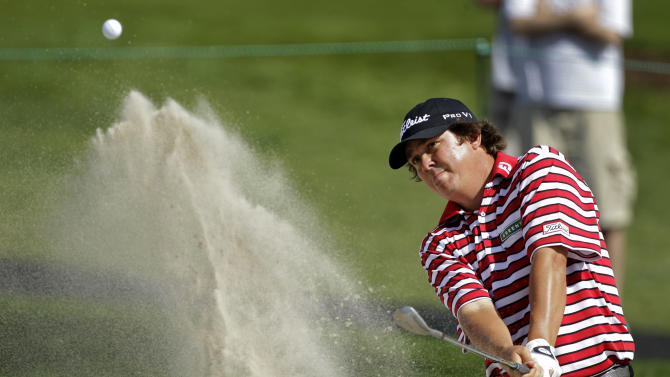 Jason Dufner hits a shot from the sand trap on the 14th hole during the first round of the Arnold Palmer Invitational golf tournament at Bay Hill, Thursday, March 22, 2012, in Orlando, Fla. (AP Photo/John Raoux)