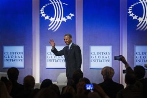 U.S. President Obama waves as he departs after a discussion about healthcare at the CGI in New York