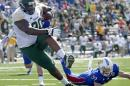 Baylor tight end LaQuan McGowan (80) gets past Kansas safety Michael Glatczak (39) to score a touchdown during the first half of an NCAA college football game, Saturday, Oct. 10, 2015, in Lawrence, Kan. (AP Photo/Charlie Riedel)
