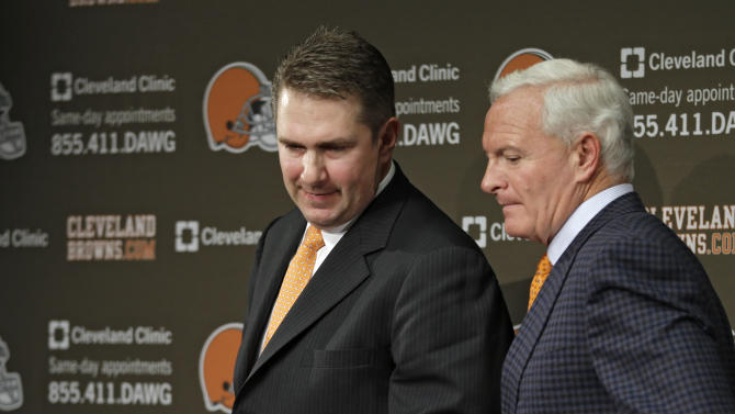 New Cleveland Browns head coach Rob Chudzinski, left, leaves his introductory news conference with owner Jimmy Haslam at the NFL football team's practice facility in Berea, Ohio Friday, Jan. 11, 2013. (AP Photo/Mark Duncan)