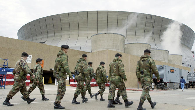FILE -In this Friday, Feb. 1, 2002 file photo, National Guardsmen patrol the Louisiana Superdome in New Orleans. It's an unprecedented security challenge for New Orleans: the city's increasingly raucous buildup to Mardi Gras gets suspended for a week as 150,000 visitors flood the town for Super Bowl. Joining the police department's 1,200-plus officers for Super Bowl week are more than 200 state troopers and about 100 officers from surrounding local jurisdictions. (AP Photo/Amy Sancetta, File)