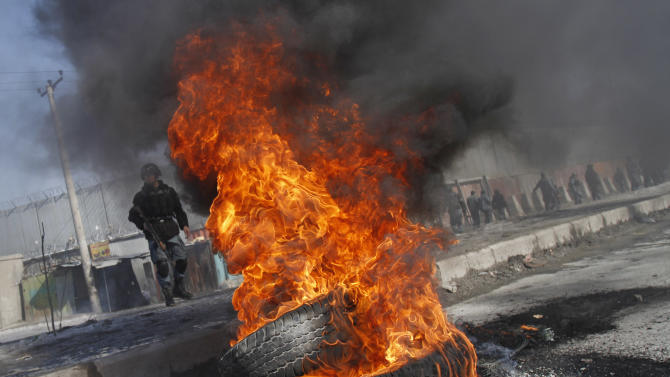 Burning tyres are seen during an anti-US demonstration in Kabul, Afghanistan, Wednesday, Feb. 22, 2012. Anti-American demonstrations erupted on the outskirts of Kabul for a second day Wednesday and in another Afghan city over an incident that the U.S. said was inadvertent burning of Muslim holy books at a military base in Afghanistan. (AP Photo/Ahmad Jamshid)