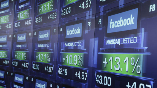 """FILE - In this Friday, May 18, 2012 file photo, electronic screens show the price of Facebook shares after they began trading in New York. Facebook Inc.'s stock took a hit Monday, Sept. 24, 2012, after an article in Barron's said it is """"still too pricey"""" despite a sharp decline since its initial public offering.  (AP Photo/Richard Drew, File)"""