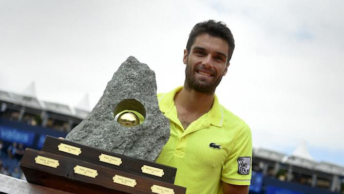 Pablo Andujar poses with the trophy after beating Argentina's Juan Monaco to win the Swiss Open in Gstaad on July 27, 2014