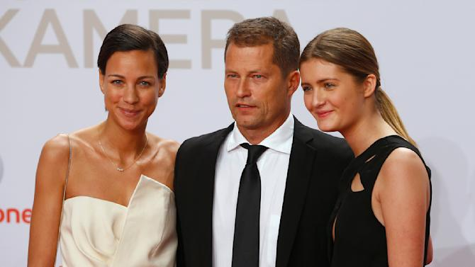 Actor Schweiger his girlfriend Shirley and daughter Lilli arrive on red carpet for Golden Camera awards ceremony in Hamburg
