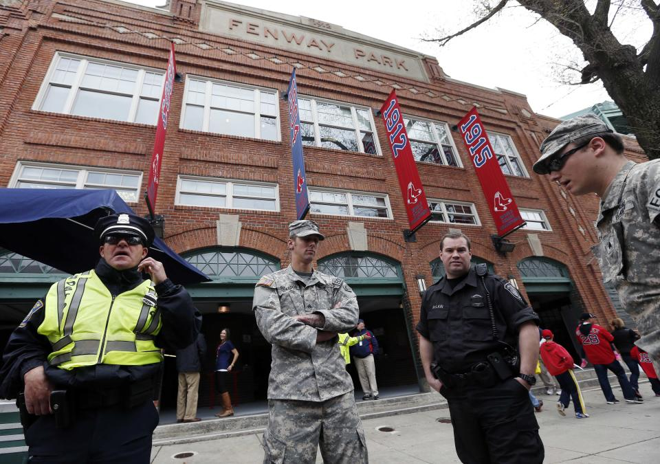 Police and National Guard soldiers stand outside Fenway Park before a baseball game between the Boston Red Sox and the Kansas City Royals in Boston, Saturday, April 20, 2013. (AP Photo/Michael Dwyer)