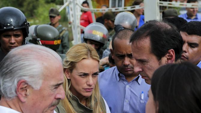 Colombia's former President Pastrana, Tintori, wife of jailed Venezuelan opposition leader Lopez, Bolivia's former President Quiroga and Venezuela's opposition leader Machado stand outside the military prison of Ramo Verde