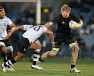 This file photo shows All Black Adam Thomson (R) fighting off a tackle by a Fiji player during a rugby union Test match in Dunedin, on July 22, 2011. Thomson has become the latest All Black to sign a lucrative contract to play club rugby in Japan, joining the Canon Eagles on a two-year deal
