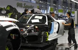 Workers assemble new Porsche 918-Spyder sports car at production line of German car manufacturer's plant in Stuttgart