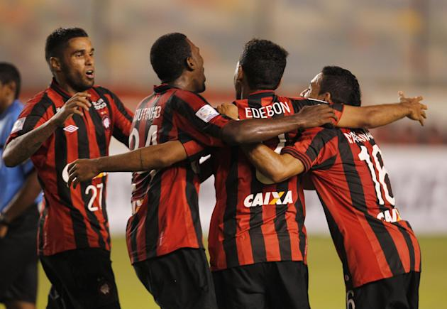 Players of Brazil's Atletico Paranaense, celebrate after scoring against Peru's Universitario during a Copa Libertadores soccer match in Lima, Peru, Thursday, March 13, 2014