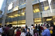 Customers line up outside an Apple store in Sydney on March 16 to buy the new iPad 3. Australia said Tuesday it would take Apple to court for misleading consumers over sales of its new iPad, claiming adverts that it can connect to a 4G network was misleading