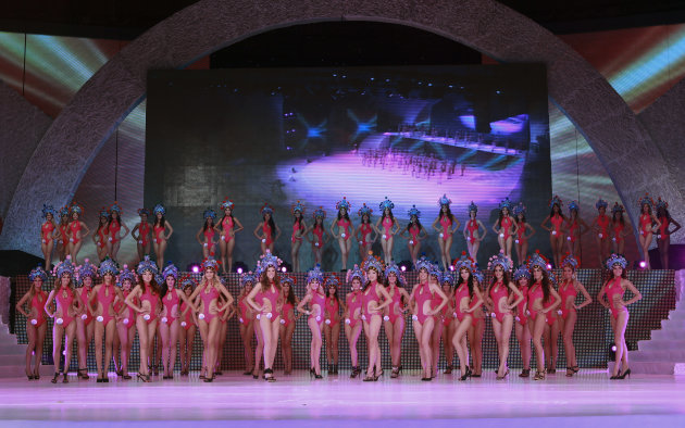 In this undated photo released by Miss Bikini International Committee on Thursday, Sept. 27, 2012, contestants in swimwears and traditional Chinese opera headpieces stage a rehearsal for their up-coming bikini competition in Beijing. A stage performance by bikini-clad women wearing headpieces styled after traditional Peking Opera has sparked debate in China after photos were made public this week, highlighting divided views on how to preserve the country's traditions. (AP Photo/Miss Bikini International Committee) EDITORIAL USE ONLY, NO SALES