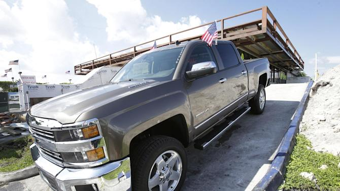 FILE - In this Oct. 1, 2014 file photo, a 2015 Chevrolet Silverado 2500 4WD LTZ Crew Cab pickup truck is on display at Miami Lakes AutoMall in Miami Lakes, Fla. General Motors reports quarterly earnings on Thursday, Oct. 23, 2014. (AP Photo/Wilfredo Lee, File)