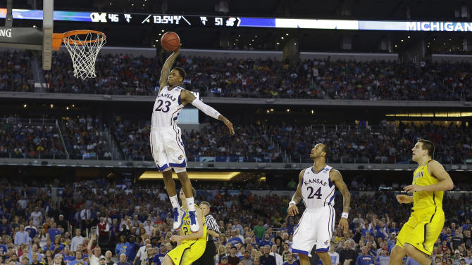 Kansas guard Ben McLemore (23) dunks against Michigan during the second half of a regional semifinal game in the NCAA college basketball tournament, Friday, March 29, 2013, in Arlington, Texas. (AP Photo/Tony Gutierrez)