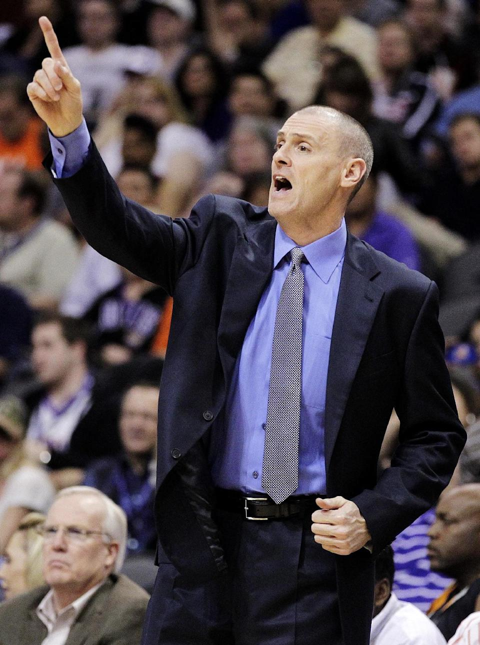 Dallas Mavericks head coach Rick Carlisle calls a play against the Phoenix Suns during the first half of an NBA basketball game, Thursday, Dec. 6, 2012, in Phoenix. (AP Photo/Matt York)