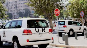 UN vehicles leave the Four Season Hotel in Damascus, …