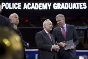 Blasio speaks with Bratton on stage during the New York City Police Academy Graduating class ceremony in New York