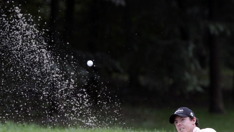 Rory McIlroy of Northern Ireland watches his shot from the sand bunker on the 3rd green during the second round of the HSBC Champions golf tournament in Shanghai, China Friday, Nov. 4, 2011. (AP Photo/Eugene Hoshiko)