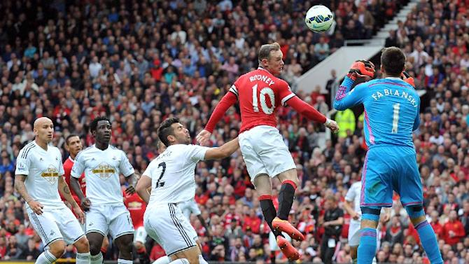 Manchester United's English striker Wayne Rooney (2nd R) heads towards goal during the English Premier League football match between Manchester United and Swansea City at Old Trafford in Manchester, north west England on August 16, 2014