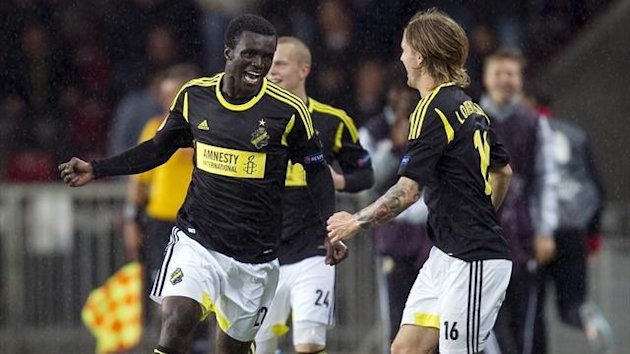 AIK Solna's Kwame Karikari (L) celebrates his goal against PSV Eindhoven with teammate Martin Lorentzon (R) during their Europa League match