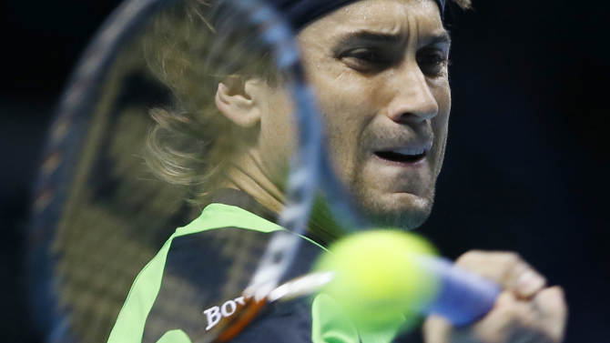 David Ferrer of Spain plays a return to Roger Federer of Switzerland during their ATP World Tennis Finals singles match in London, Thursday, Nov. 8, 2012. (AP Photo/Kirsty Wigglesworth)