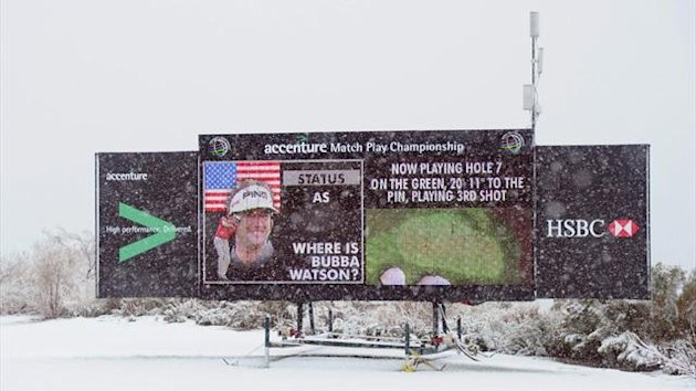 "Snow falls as the video board reads ""Where is Bubba Watson?"" as play was suspended due to weather during the first round of the World Golf Championships World Match Play event (AFP)"