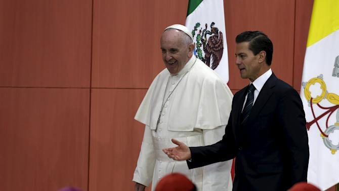 Pope Francis and Mexico's President Enrique Pena Nieto participate in a ceremony at the National Palace in Mexico City,