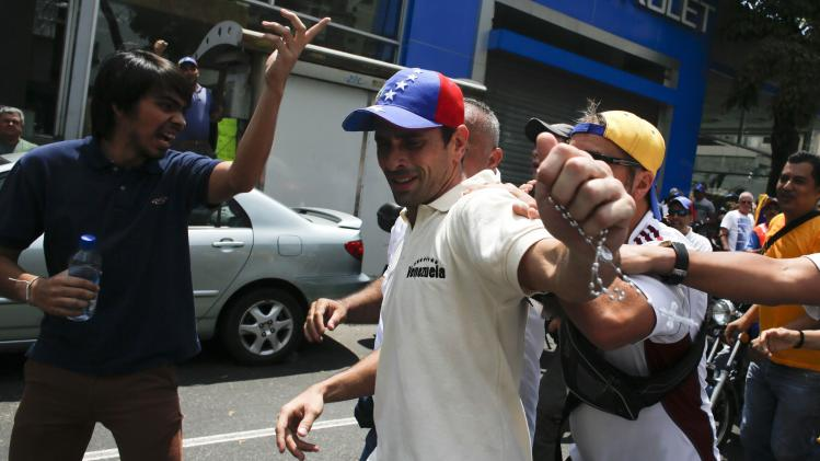 Opposition leader Henrique Capriles Radonski greets supporters during an anti-government protest in Caracas