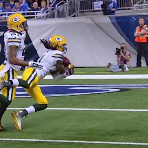 Green Bay Packers cornerback Davon House intercepts Detroit Lions quarterback Matthew Stafford