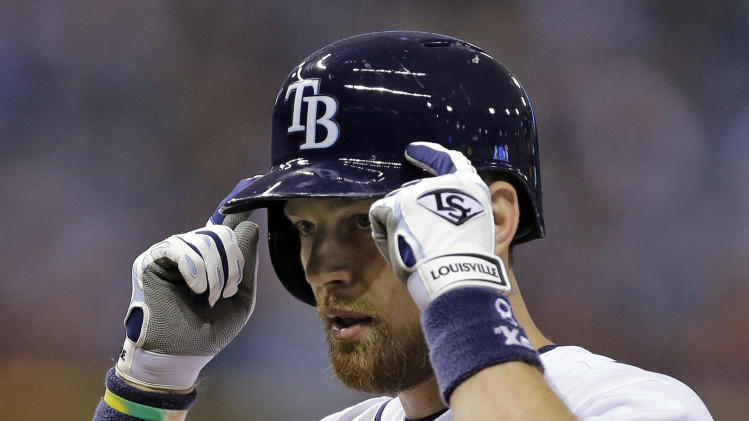 Tampa Bay Rays' Ben Zobrist reacts toward his dugout after his RBI-single off Boston Red Sox starting pitcher Jon Lester during the seventh inning of a baseball game on Friday, July 25, 2014, in St. Petersburg, Fla. Rays' Cole Figueroa scored on the hit. (AP Photo/Chris O'Meara)