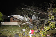 A house in the Midtown section of Mobile, Ala. is damaged after a tornado touched down Tuesday, Dec. 25, 2012. A Christmas Day twister outbreak left damage across the Deep South while holiday travelers in the nation&#39;s much colder midsection battled sometimes treacherous driving conditions from freezing rain and blizzard conditions. (AP Photo/AL.com, Mike Kittrell) MAGS OUT