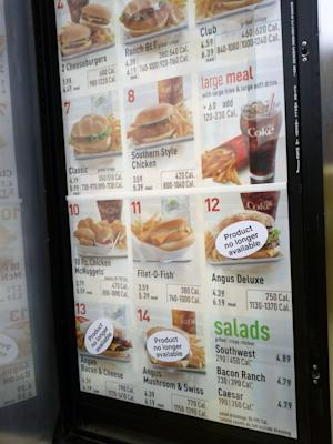 This Thurday, May 9, 2013, photo, shows a McDonald's menu in Detroit.  On Thursday, May 9, 2013, McDonald's said it is cutting the Angus burger from its menu. McDonald's had said earlier this year that it was evaluating whether to continue selling the Angus Third Pounders, which were introduced in 2009 and among the chain's priciest. The company also said at the time that it was it was cutting Chicken Selects and Fruit & Walnut Salad. (AP Photo/McDonald's is cutting the Angus burger from its menu. (AP Photo/Mike Lee)