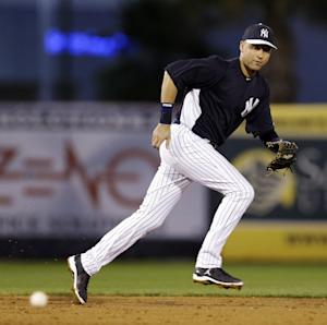 New York Yankees shortstop Derek Jeter chases down an RBI single by Philadelphia Phillies' Domonic Brown during the third inning of their exhibition spring training baseball game in Tampa, Fla., Wednesday, March 13, 2013. The game marked Jeter's first time playing the field since breaking his left ankle in the first game of the American League championship series last October. (AP Photo/Kathy Willens)
