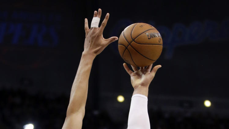 Los Angeles Clippers' Blake Griffin, right, shoots over New Orleans Hornets forward Anthony Davis during the first half of an NBA basketball game in Los Angeles, Wednesday, Dec. 19, 2012. (AP Photo/Chris Carlson)