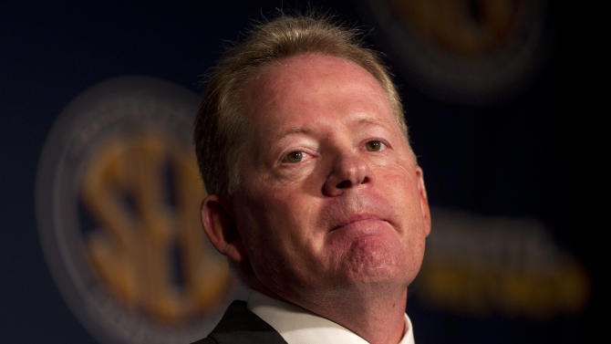 Arkansas coach Bobby Petrino talks with reporters during Southeastern Conference Football Media Days in Birmingham, Ala., Wednesday, July 20, 2011.   (AP Photo/Dave Martin)