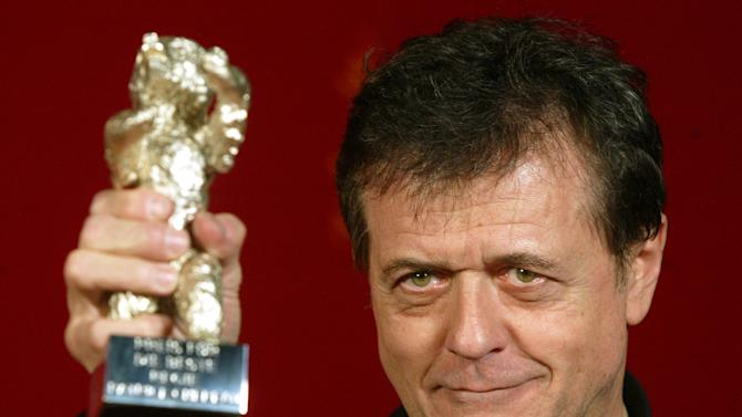 "FILE - In this Saturday, Feb. 15, 2003 file photo French director Patrice Chereau holds up the Silver Bear award for the Best Director for his movie ""Son Frere"" (His Brother) at the 53rd Berlinale Film Festival. Patrice Chereau, a celebrated and award-winning French actor and director in film, theater and opera who was renowned for cutting-edge productions, has died, officials said Tuesday Oct. 8, 2013. He was 68. (AP Photo/Markus Schreiber, File)"