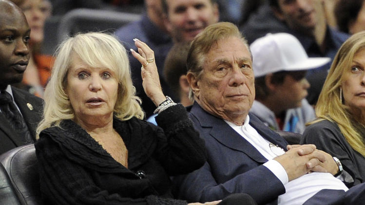 In this Nov. 12, 2010 file photo, Los Angeles Clippers owner Donald T. Sterling, right, sits with his wife Shelly during the Clippers NBA basketball game against the Detroit Pistons in Los Angeles. Donald Sterling has agreed to surrender his stake of the Clippers to his wife, and she is moving forward with selling the team. A person with knowledge of the negotiations told The Associated Press Friday.May 23, 2014, that the couple made the agreement after weeks of discussion. The individual wasn't authorized to speak publicly about the agreement