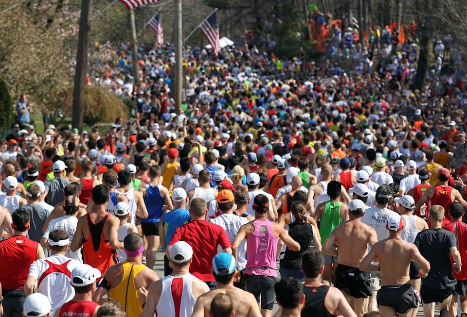 Runners start the 116th running of the Boston Marathon, in Hopkinton, Mass., Monday, April 16, 2012. (AP Photo/Stew Milne)