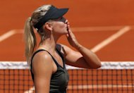 "Serena Williams is a frequent user of Twitter as is Caroline Wozniacki, but the world's best paid sportswoman Maria Sharapova (pictured on May 29) has little time for it. ""I think it's too much for me,"" she said after winning her way through to the last 16 of the French Open on Friday"