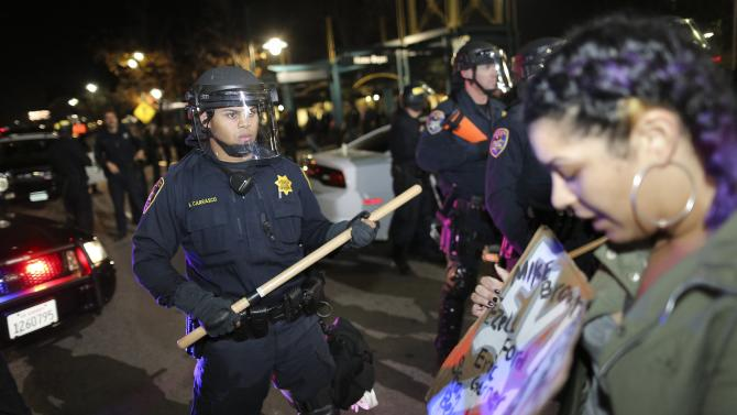 Police officers hold a line during the second night of demonstrations in Emeryville, California