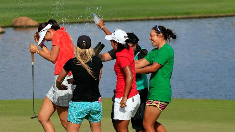 Michelle Wie is congratulated by fellow golfers on the 18th green after winning the LPGA LOTTE Championship Presented by J Golf on April 19, 2014 in Kapolei, Hawaii
