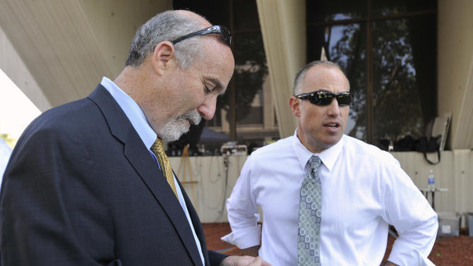 """FILE - In this Sept. 6, 2012 file photo, Joel Brodsky, left, and Steven Greenberg, attorneys for former Bolingbrook police officer Drew Peterson, confer outside the Will County Courthouse in Joliet, Ill., during the jury deliberations in Peterson's murder trial. Brodksy, the one-time lead attorney for Peterson, has filed a lawsuit Wednesday, Feb. 6, 2013,  claiming that Greenberg, who is still on Peterson's legal team defamed him. The lawsuit filed in Cook County Circuit Court says Greenberg circulated a letter accusing Brodsky of """"single-handedly"""" losing Peterson's trial. (AP Photo/Paul Beaty, File)"""