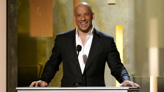 "FILE - In this Feb. 22, 2014 file photo, Vin Diesel speaks on stage at the 45th NAACP Image Awards at the Pasadena Civic Auditorium in Pasadena, Calif. Diesel said he took the role in the ""The Last Witch Hunter"" because the last year was hard for him, so playing a character that masked his sorrow was very appropriate. (Photo by Chris Pizzello/Invision/AP, File)"