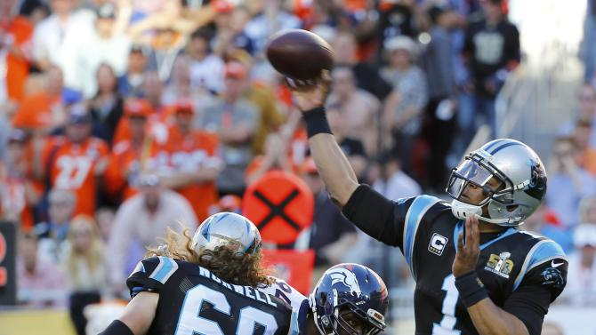 Carolina Panthers' quarterback Newton throws a pass in the first quarter as Panthers' Norwell blocks during the NFL's Super Bowl 50 football game against the Denver Broncos in Santa Clara