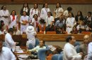 Nuns react as they observe lawmakers tackle whether or not to terminate the debates on the Reproductive Health (RH) Bill during a session in the House of Representatives in Quezon City, Metro Manila