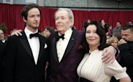 "Veteran actor Peter O'Toole (C) with his son Lorcan and daughter Kate at the 79th Academy Awards in Hollywood, California, in 2007. O'Toole's first stage role came at the age of 17. He started out on stage in Bristol and London before his big break in director David Lean's ""Lawrence of Arabia"" (1962)"