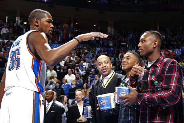 Kevin Durant meets Hugo basketball player Trey Johnson, at right — Sara Phipps/The Oklahoman