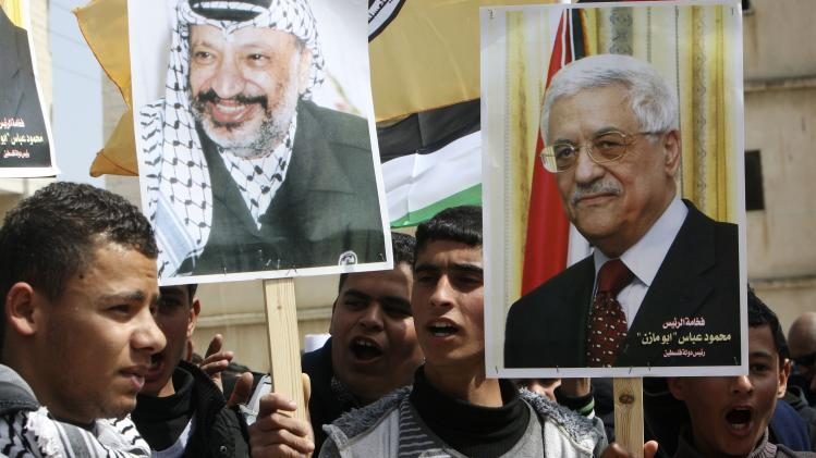 Palestinian Fatah supporters hold placards during a rally near Jenin