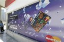 A sign displaying ATM prepaid cards is seen at a RAKBANK branch at Dubai Marina